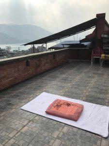 Rooftop yoga overlooking Pokhara